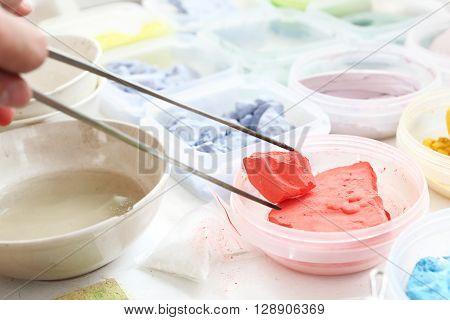 Coloured pigments painting . ceramic pigments .