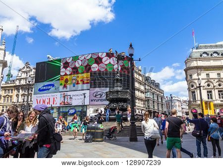 LONDON UK - JUNE 7 2015: Unidentified tourists on Piccadilly Circus road junction built in 1819 famous tourist attraction links to West End Regent Street Haymarket Leicester Square