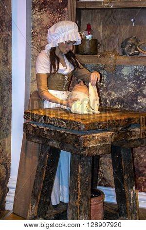 LONDON UK - JUNE 7 2015: Madame Tussaud's figure in the Madame Tussauds museum in London. Marie Tussaud was born as Marie Grosholtz in 1761