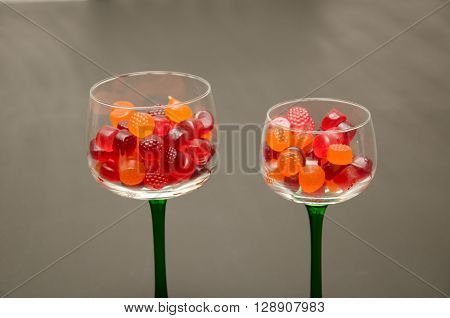 Duo of Green Stemmed Wine Glasses with Colorful Candy