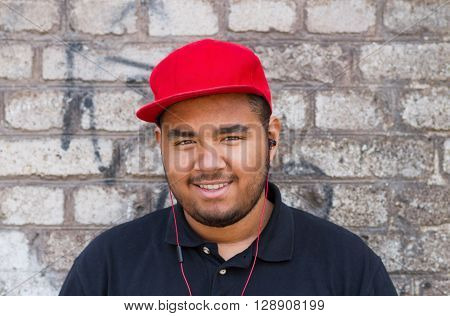 Friendly Young Black Boy In Headphones