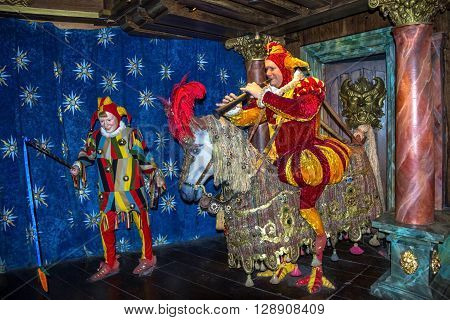 LONDON UK - JUNE 7 2015: Clown wax figures demonstrate medieval representation on city streets at Madame Tussauds museum. Madame Tussauds London is famous for recreating famous people and celebrities in wax. It is located in the former London Planetarium.