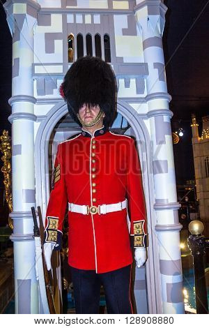 LONDON UK - JUNE 7 2015: Wax figure of Royal Guard at Madame Tussauds museum. British Guards in red uniform are the sign of London.