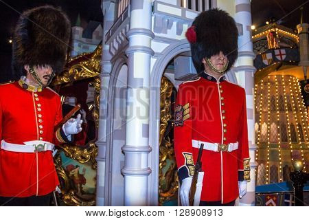 LONDON UK - JUNE 7 2015: Wax figures of Royal Guards at Madame Tussauds museum. British Guards in red uniform are the sign of London.