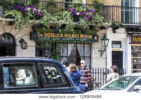 LONDON UK - JUNE 6 2015 : Facade of the Sherlock Holmes house and museum in 221b Baker Street. Here is where Arthur Conan Doyle located the studio of the famous detective.