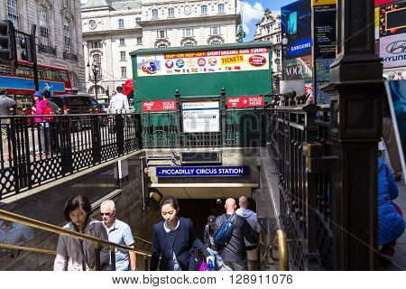 LONDON - JUNE 7 2015: Unidentified people at Piccadilly Circus underground tube station. London's underground railway is the oldest in the world dating back to 1863.