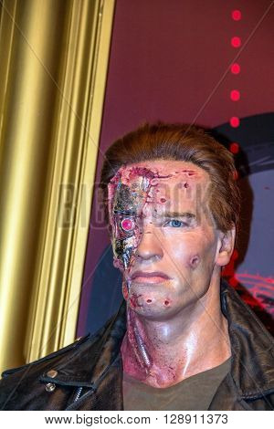 LONDON UK - JUNE 7 2015: Arnold Schwarzenegger as the Terminator in the Madame Tussauds wax museum. Marie Tussaud was born as Marie Grosholtz in 1761