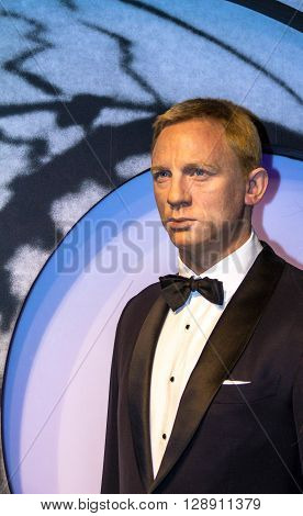 LONDON UK - JUNE 7 2015: Daniel Craig as the agent 007 James Bond in Madame Tussauds museum in London. Marie Tussaud was born as Marie Grosholtz in 1761