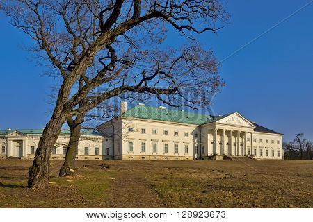 The chateau Ka?ina is among the most significant buildings of empire architecture in Bohemia - winter photo side towards to the park with pair black locust trees without leaves and without snow