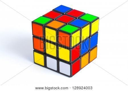 BUDAPEST, HUNGARY - MAY 1, 2016: Unsolved Rubik's cube logic game on white studio background