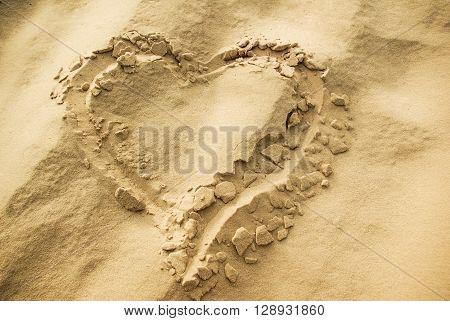 A heart shape drawn on a sand