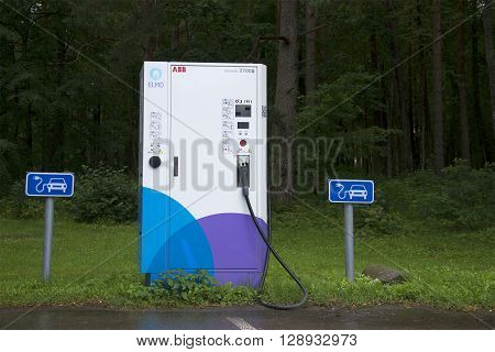PADISE, ESTONIA - AUGUST 01, 2015: The electric vehicle charging point in the Parking area in Padise. An alternative source of gasoline. Environmental program