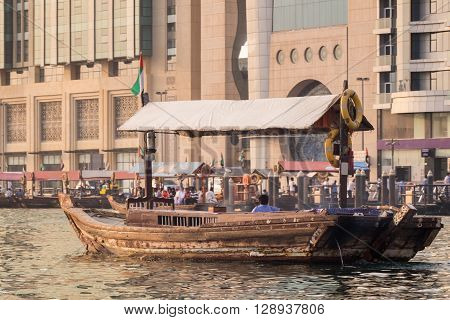 Abra Water taxi on Dubai creek with only the driver in it no passengers.