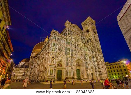 FLORENCE, ITALY - JUNE 12, 2015: Iliminated front of Florence Cathedral, imporsing and beautiful building, mix of colors