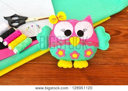 Felt owl - how to sew a felt toy. Felt sheets, scissors, thread, needle, pins - sewing kit owl. Do it yourself. poster