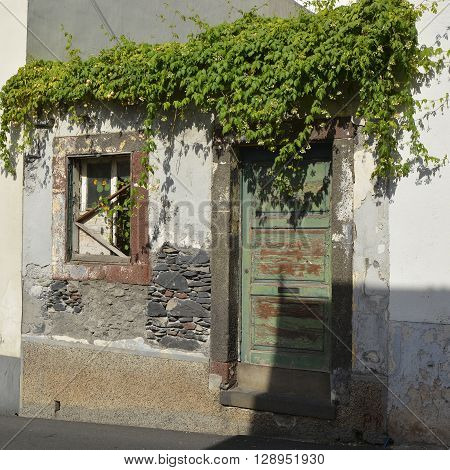 Doorway and window to disused and abandoned house in Funchal Madeira Portugal