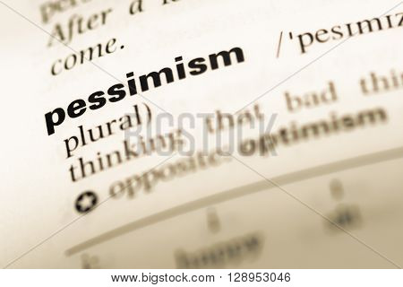 Close Up Of Old English Dictionary Page With Word Pessimism.