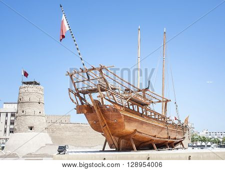 Dubai ,UAE - April 6 2016 : Historical museum in Dubai United Arab Emirates. Arabic Dhow in Dubai historical museum.