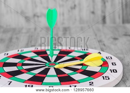black and whitte tone , Dart hit the center of dartboard poster