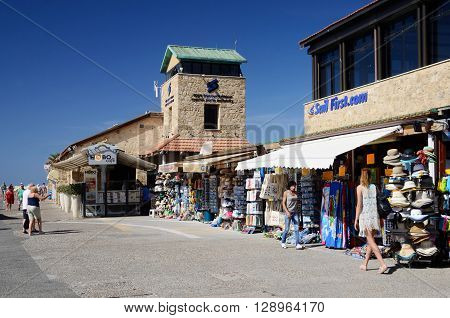 PAPHOS CYPRUS - APRIL 20 2016:Unidentified tourists shopping and walking at New Paphos harbour in Paphos,Cyprus on April 20 2016.It is island country in Eastern Mediterranean Sea