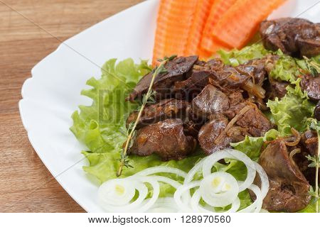 Appetizing chicken liver cooked with onions lettuce and spices