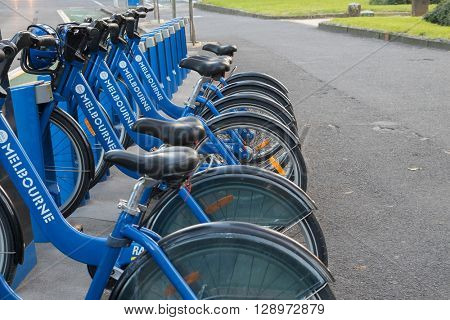 MELBOURNE, AUSTRALIA - APRIL, 2016 : Line of blue bicycles parking at the Melbourne Bike Share station in Melbourne, Australia on April 09, 2016. It is designed for short rides between stations