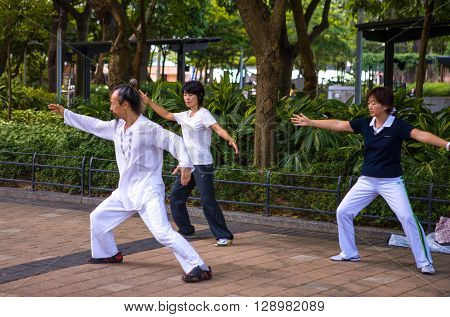 Hong Kong China - September 27 2007: A Tai Chi training in the Victoria park