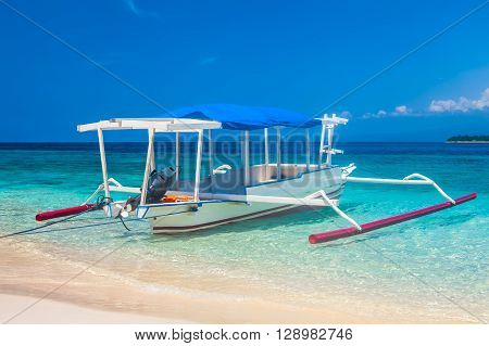 traditional Indonesia boat Jukung on a tropical beah