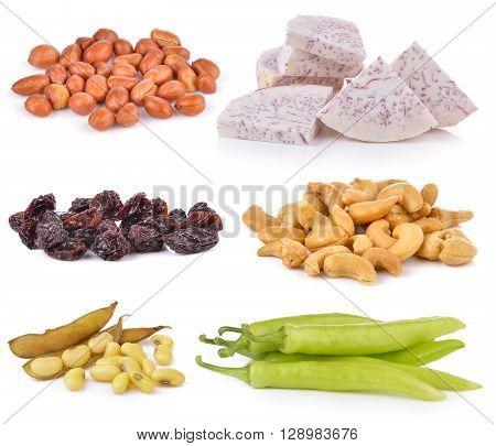 soy bean Dried raisins chili pepper Cashews slice taro root peanats on white background