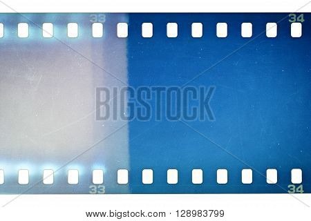 Blank grainy film strip texture background with lots of dust noise and light leak isolated on white