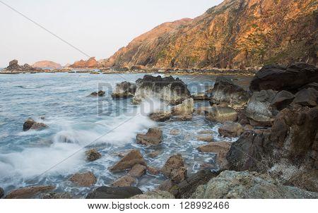 Rocky edge on a tropical beach shore at Eo Gio, Quy Nhon, Vietnam
