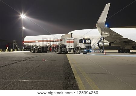 Refueling a plane at night