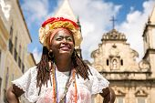 Brazilian woman of African descent wearing traditional clothes from the state of Bahia in the old co