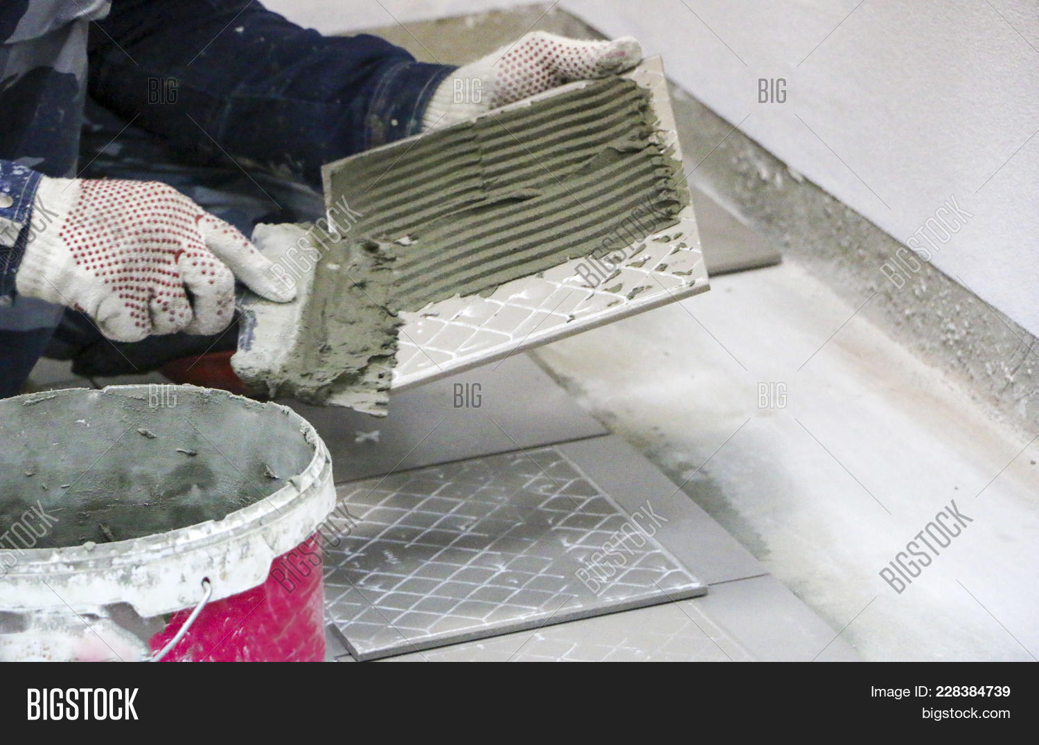 Repairs laying floor ceramic tiles image photo bigstock laying of floor ceramic tiles mens hands in gloves with spatula spread dailygadgetfo Gallery
