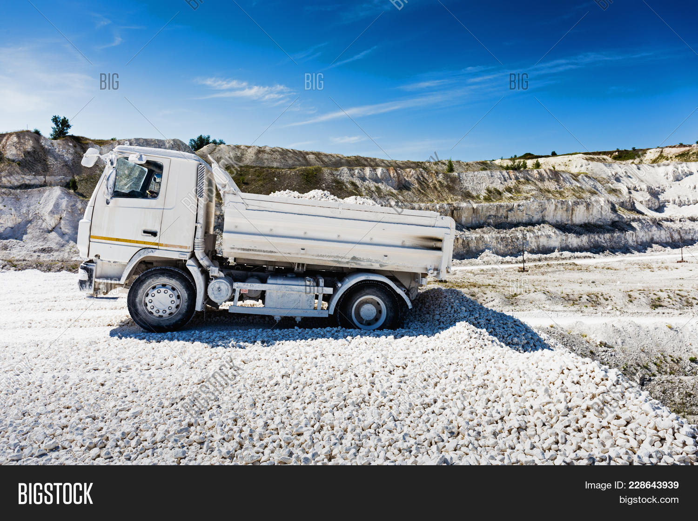 Quarry Truck Unloads Image & Photo (Free Trial)   Bigstock
