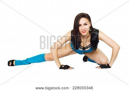 Young Beautiful Woman Dressed In Blue Fitness Clothes Is Engaged In Fitness Isolated On White Backgr