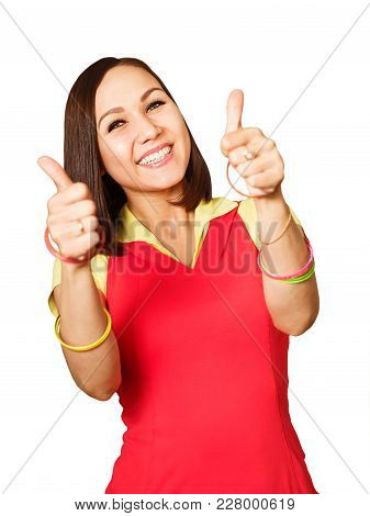 Close Up Portrait Of Young Beautiful Woman Dressed In Red Fitness Clothes Showing Thumbs Up And Smil