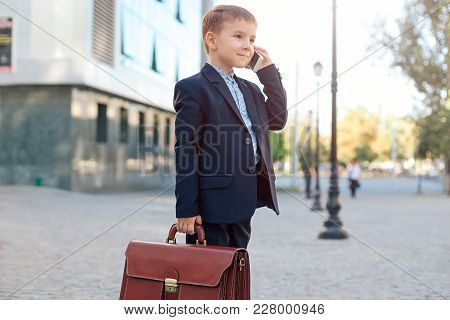 Concept Future Businessman. High Angle Of Businessman In Formal Wear Standing On Pedestrian Street C