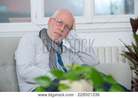 A Middle-aged Man Relaxing A Moment In Sofa