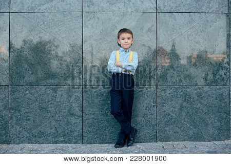 Shot Outdoors, Boy, Future Businessman, Wearing Yellow Suspenders, Dark Blue Pants And Blue Shirt Ag