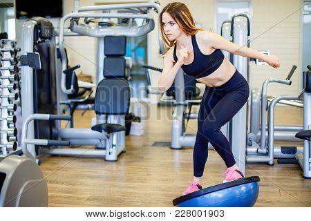 Young Woman Doing Exercise On Bosu Ball