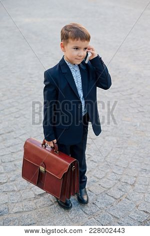 Concept Future Businessman. Full Length Portrait Of Smiling Businessman In Formal Wear Standing On P