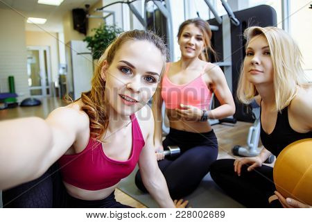 Group Of Women Smiling And Taking A Selfie At The Gym