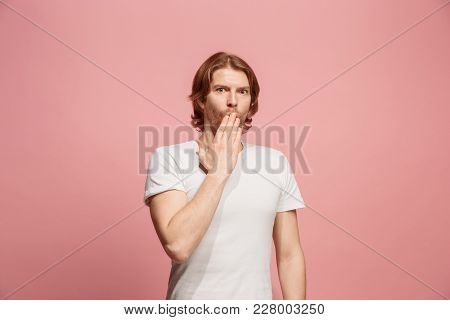 Secret, Gossip Concept. Young Man Whispering A Secret Behind Her Hand. Business Man Isolated On Tren