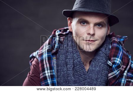 Studio Portrait Of Stylish Casual Male Dressed In A Red Shirt And Braces.