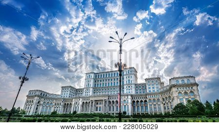 Historic Parliament Of Bucharest Against A Blue Sky