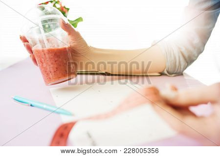 Centimeter, Pen, Dieting And People Concept - Close Up Of Woman Hands With Fruits And Fresh Juice Si