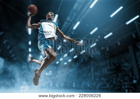 Basketball Player In Motion Or Movement On Big Professional Arena During The Game. Player Making Sla