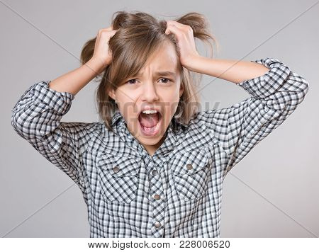 Close-up Emotional Portrait Of Attractive Angry Child Teenager Girl Screaming Wide Open Mouth. Funny