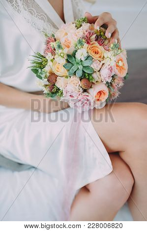Bride With A Beautiful Bouquet Of Different Flowers In The Hotel